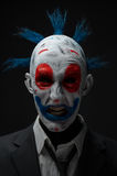 Clown crazy zombies red blue in a jacket royalty free stock photo