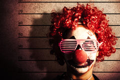 Clown criminal mug shot photo ID on police lines Stock Photography
