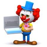 Clown 3d lernt, wie man einen Laptop-PC benutzt Stockfotografie