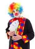 Clown montrant le grand argent Photo stock
