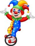 Clown de bande dessinée montant un vélo de roue Image stock