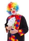Clown, der großes Geld zeigt Stockfoto