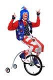 Clown, der einen Unicycle reitet Lizenzfreies Stockfoto