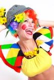 Clown, der zum Exemplarplatzbereich schaut Stockbilder
