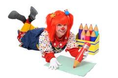 Clown die het Schrijven bepaalt Stock Foto