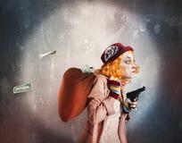 Clown discovered while robbing. Woman clown discovered while robbing much money Stock Images