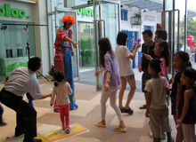 The clown is distributing the balloon toys in SHENZHEN Royalty Free Stock Images