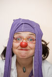 Clown doctor. Clown-doctor : clown with red nose and pantyhose on the head with foolish expression in her face Stock Image