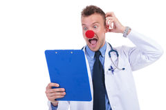 Clown doctor unable to read the notes Stock Photography