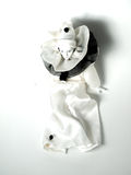 Clown doll. Porcelain clown doll in white dress with black and white necklace and beanie hat Stock Photos