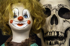 Clown doll and skull Royalty Free Stock Photography