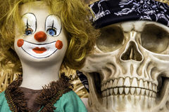 Clown doll and skull Royalty Free Stock Images