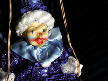 Clown doll on swing. Childhood remembered, innocence celebrated Royalty Free Stock Photo