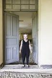 Clown door. Clown in abandoned house door, fear and halloween royalty free stock photo