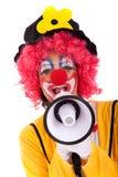 Clown drôle avec un mégaphone Photos stock