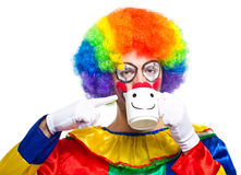 Clown drinking from a cup Royalty Free Stock Photo