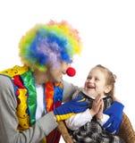 Clown en meisje Stock Afbeeldingen