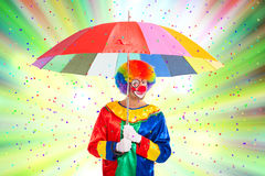 Clown enjoying a confetti rain Stock Photography