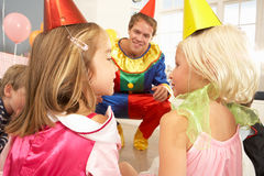 Clown entertaining children. At party Royalty Free Stock Photos