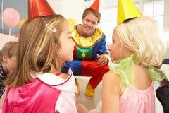 Clown entertaining children at party stock photos