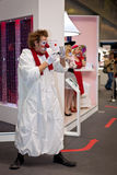 Clown entertaining visitors at Canon stand. At Consumer Electronics & Photo Expo, 14th of April 2013 in Moscow, Russia stock photography