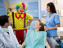 Clown entertains girl in dental ambulance Royalty Free Stock Photo