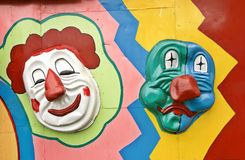 Clown faces. Clolorful clown faces on the wall Stock Photo
