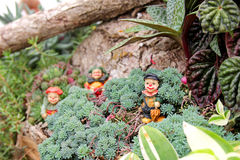 Clown Figures in Miniature Fairy Flower Garden Royalty Free Stock Images