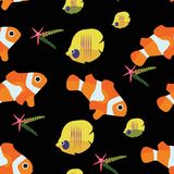 Clown fish and starfish chaetodon seamless pattern vector illustration