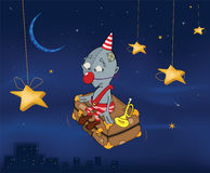 The clown flies on a suitcase.Celebratory night. C. The sad clown flies on a suitcase over a night city Royalty Free Stock Image