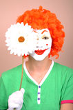 Clown with flower Royalty Free Stock Images