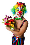 Clown with flowers Stock Images