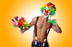 Clown with flowers Stock Image