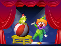 A clown and a frog performing on stage Royalty Free Stock Photography
