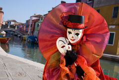 Clown in front of canal on Burano Island Stock Photography