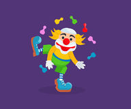 Clown in funny clothes, entertains and amuses the audience Stock Photo