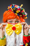 The clown in funny concept on dark background. Clown in funny concept on dark background Royalty Free Stock Image