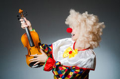 Clown in funny concept on dark background Royalty Free Stock Photography