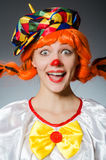 Clown in funny concept on dark background Royalty Free Stock Photos