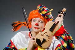 Clown in funny concept on dark background Stock Image