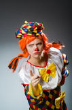 Clown in funny concept on dark background Royalty Free Stock Photo