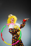 Clown in funny concept on dark background Royalty Free Stock Image