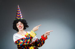 Clown in funny concept on dark background Stock Photo
