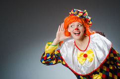 The clown in funny concept on dark background Stock Photo