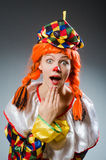 The clown in funny concept on dark background. Clown in funny concept on dark background Stock Photography
