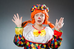 The clown in funny concept on dark background. Clown in funny concept on dark background Royalty Free Stock Photography