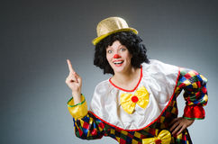 Clown in funny concept on dark background Stock Images