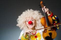 The clown in funny concept on dark background Stock Photos