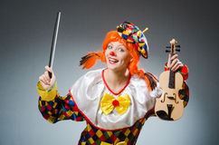 The clown in funny concept on dark background Royalty Free Stock Photo