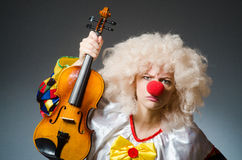 The clown in funny concept on dark background Royalty Free Stock Image